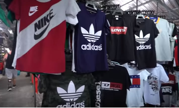 Fake sports shirts on sale in Thailand. A bargain for Thais and part of the Thai economy