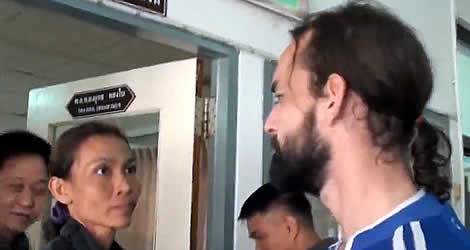 Thai woman and French man say Goodbye leaving for a Thai prison after being convicted of murder