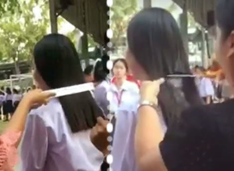Thai teachers rule as 4th year teenage student has hair cropped in public after defying school code