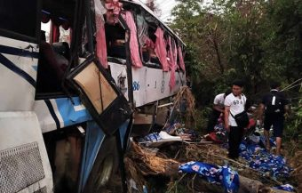 Thai emergency rescuers cry as they meet 3 year old boy in Nakhon Ratchasima bus accident site
