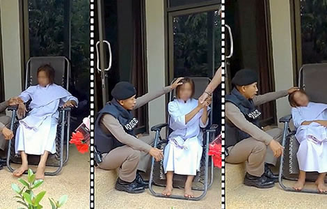 Thai police captain helps woman lose spirit that was damaging her health in call out video that went viral