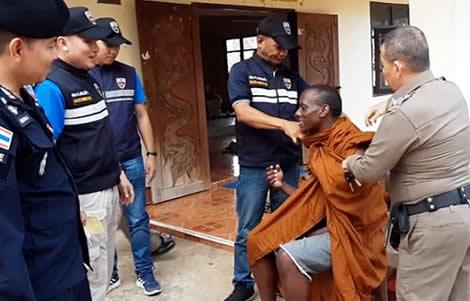thailand-ugandan-african-man-fake-buddhist-monk-thai-immigration-police-sa-kaeo