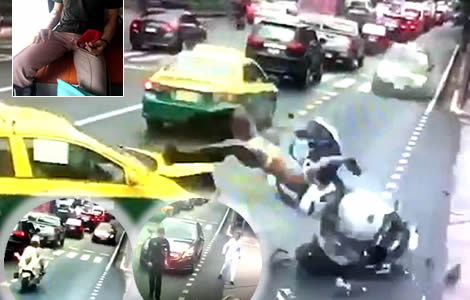 Military police officer flies off his motorbike in Bangkok while