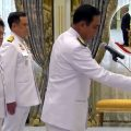 PM urges ministers to 'create a sense of unity' in the country as Thai King swears in new cabinet