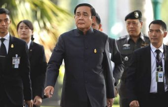 Apology by Thai PM also contains a warning about the 'old solutions' to political deadlock meaning a coup