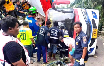Two tour bus passengers dead after vehicle overturned near the top of a scenic hill in the South of Thailand
