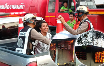 Thai man maddened by drink and love burns down his home and is taken away by police laughing