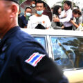 Protester charged with harming the Queen's liberty claims innocence after his arrest on Friday in Bangkok
