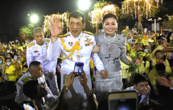 King tells western TV crews that he loves all Thai people equally and the kingdom is the land of compromise