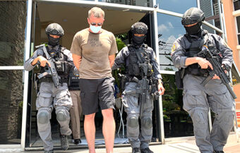 Two Americans arrested over kidnapping linked with failed gloves deal and loss of ฿93 million