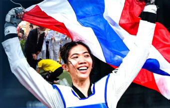Gold medalist pays solemn respect to her father as she makes her triumphant return to Thailand